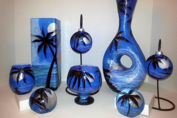blue handmade glass art with palm trees beach theme