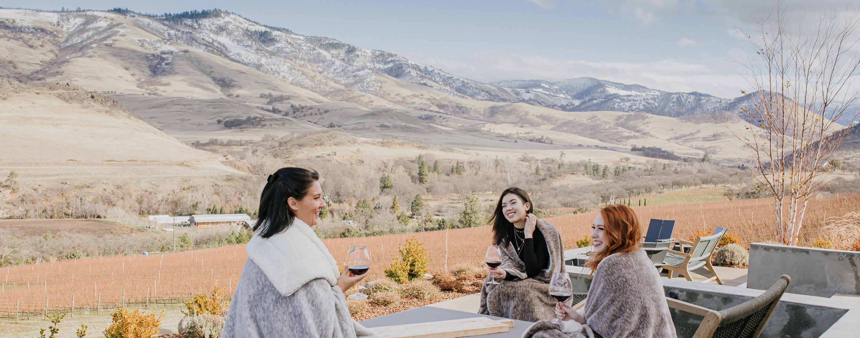 Friends enjoying wines at Irvine & Roberts Vineyards
