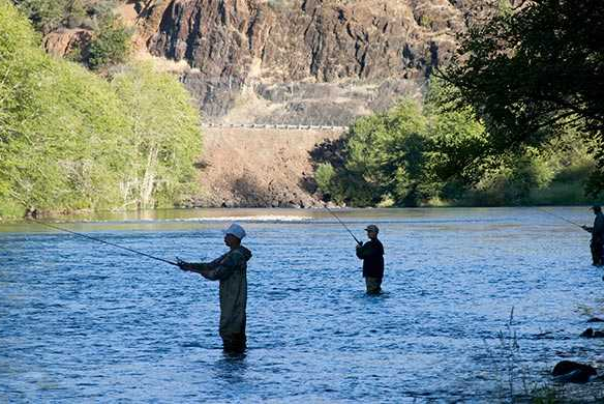 Flyfisherman fishing at the Casey State Recreation Park in Trail Oregon