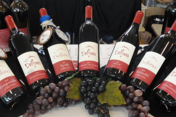 delfino wine bottles with grape decorations