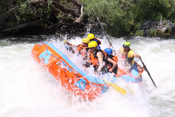 Friends enjoying whitewater rafting on the Rogue River