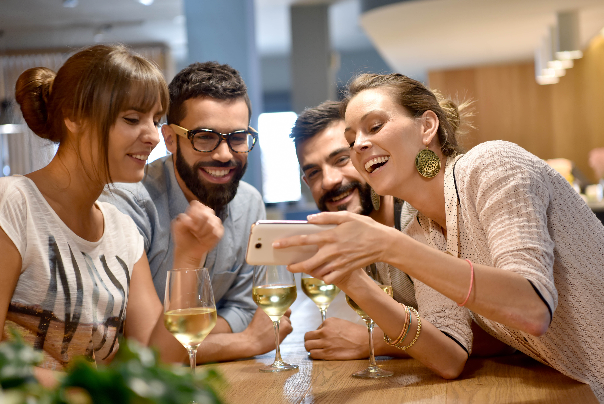 A group of friends enjoying wines